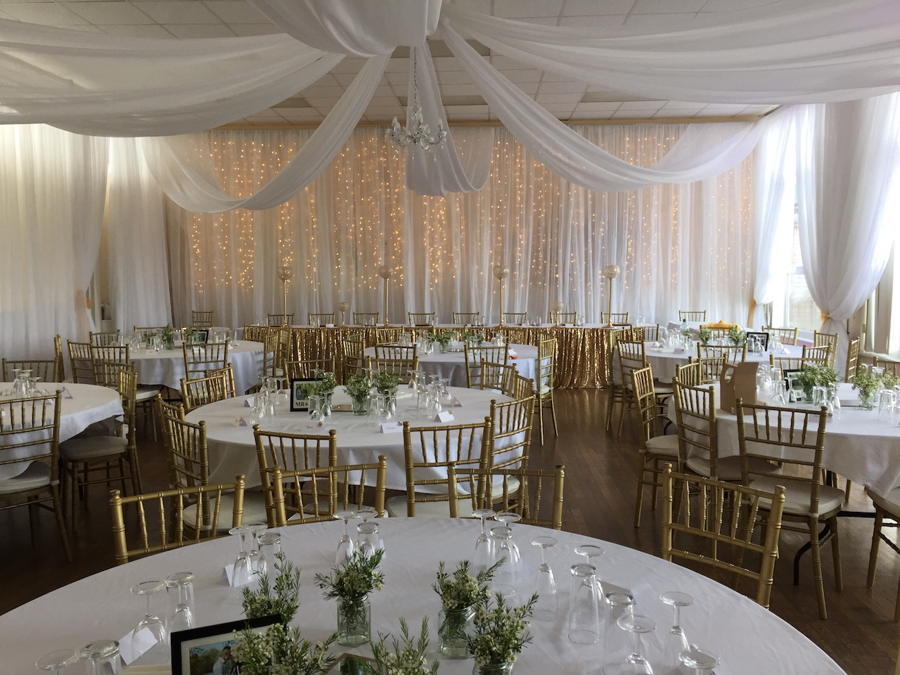 Fairy lights backdrop with flowing ceiling drapes at Central London Golf centre