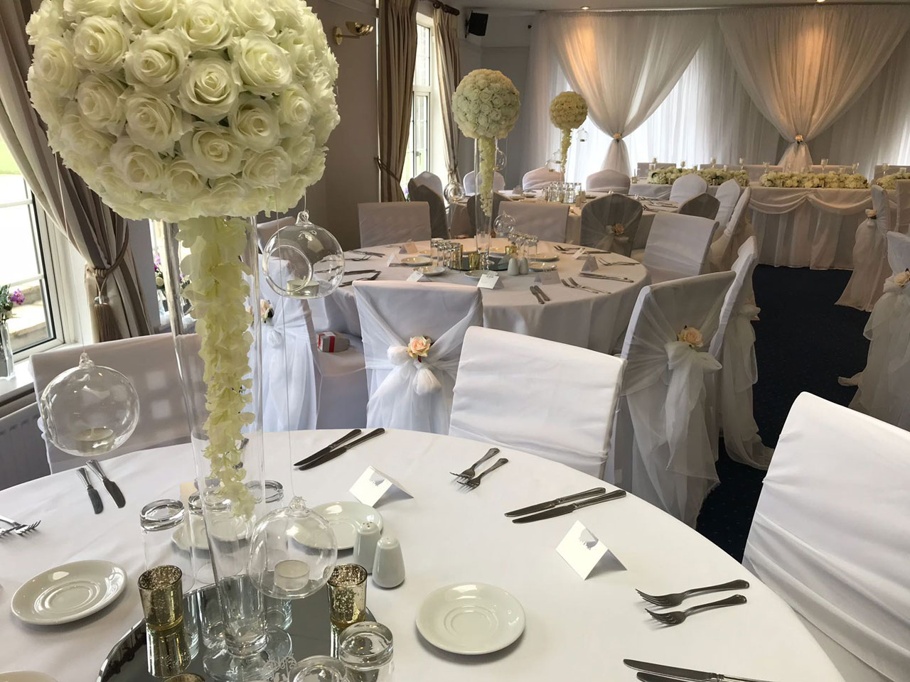 Muswell Hill Golf Club - ivory rose ball tall vase centrepiece