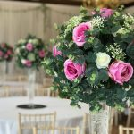 rose, eucalyptus and foliage tall cone centrepiece